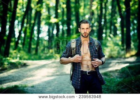 Tourist Campaign. Attractive Tourist With Backpack. Tourist Traveling Alone In Nature Landscape. Han