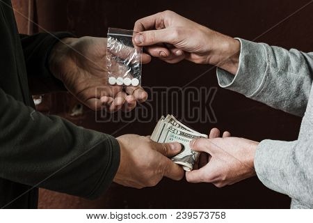 Hand Of Addict Man With Money Buying Dose Of Cocaine Or Heroine Or Another Narcotic From Drug Dealer
