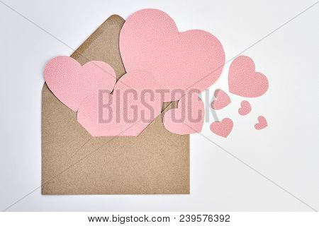 Opened Envelope And Pink Paper Hearts. Valentines Day Envelope From Craft Paper And Decorative Heart