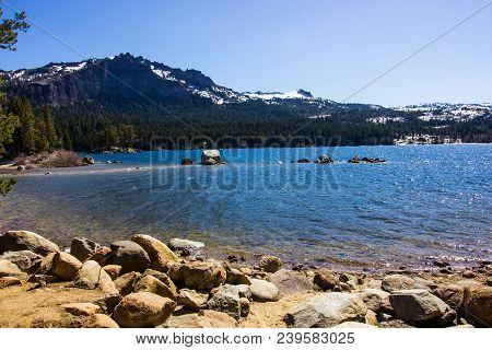 Mountain Lake With Shallow Shoreline In Springtime