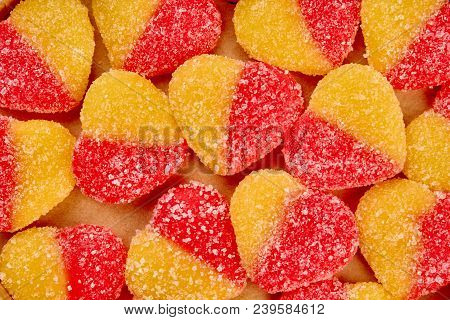 Jelly Heart Shaped Candies Background. Close Up Background Of Sugar Coated Colored Heart Shaped Jell