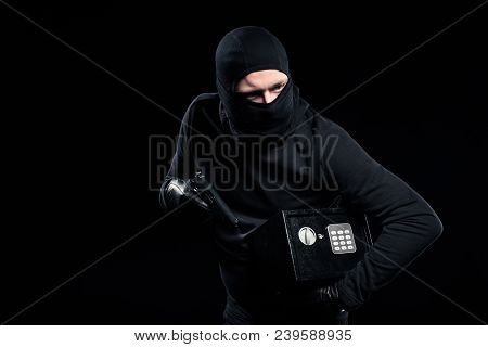 Burglar In Balaclava Holding Gun And Locked Safe