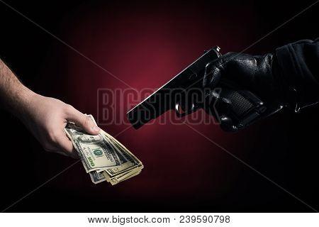 Burglar With Gun Robbing Man With Dollars