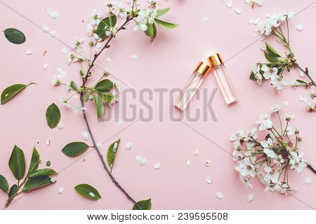 Two Bottles Of Perfume With Apricot Blossom