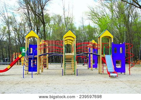 Childish Playground In City Park. Swing Carousel In Park For Children