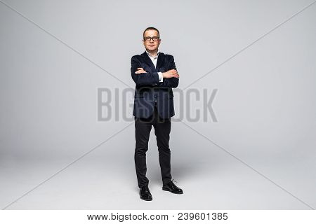 Full Length Picture Of A Mid Aged Business Man Smiling With His Arms Crossed. Isolated On White Back