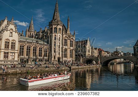 Ghent, Belgium - July 03, 2017. St Michael Bridge, People And Gothic Building In Ghent. In Addition