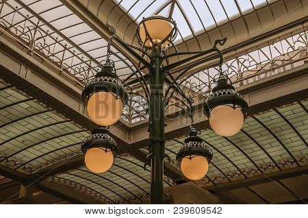 Brussels, Central Belgium - July 04, 2017. Art Nouveau Lamp And Glass Ceiling In An Old Building, At