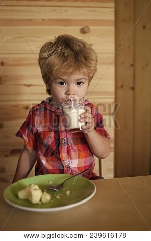 Small Boy Child Eat Banana And Drink Milk. Healthy Food And Vitamin. Childhood And Happiness, Indepe