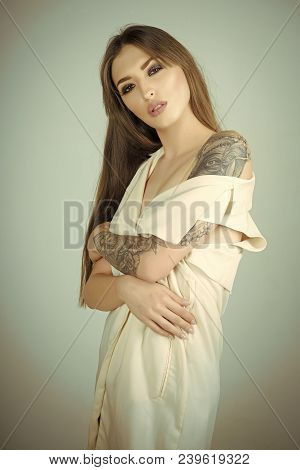 Woman With Long Brunette Hair, Hairstyle, Beauty, Salon. Sensual Woman With Tattoo Painting, Fashion
