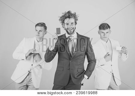 Three Men Holding Blank Cards. Business Team Smiling On Grey Background. Banking And Saving Concept.