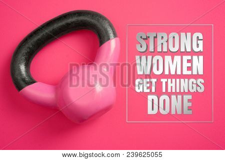 Kettle Weights On Pink Background With Inspirational Quote. Strong Women Get Things Done.