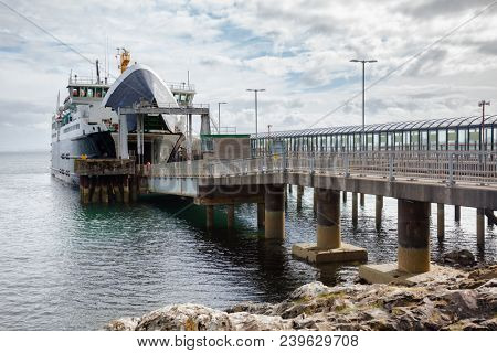 Passenger ferryboat at terminal ready to be loaded, Inner Hebrides off the west coast of Scotland UK