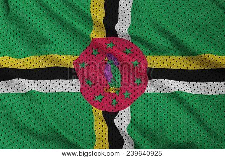 Dominica flag printed on a polyester nylon sportswear mesh fabric with some folds poster