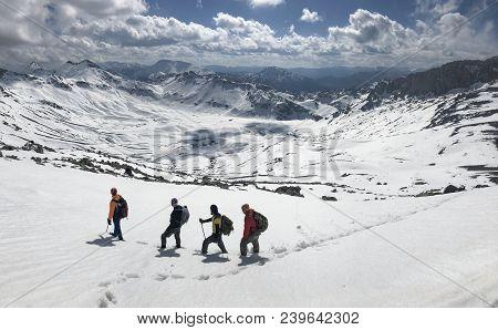 Winter Hiking Activity At Peak Mountains;trekking And Summit