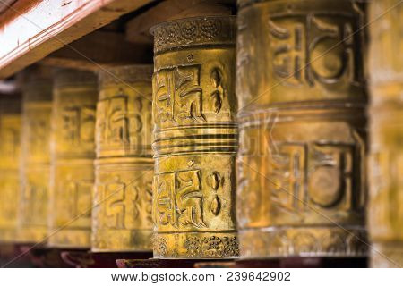Tibetan buddhist praying wheels in Ladakh, India. Traditionally, the mantra Om Mani Padme Hum is written in Sanskrit on the outside of the wheel