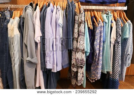 Fashionable Clothes In A Boutique Store Multicolored Womens Clothing Hanging On The Hanger