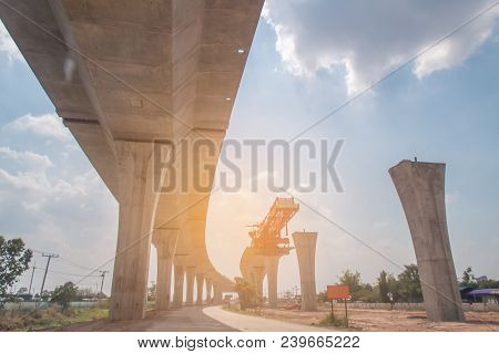 Construction Site Of A Mass Transit Train Line In Progress With Heavy Infrastructure, Building Road