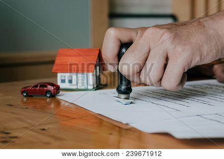 Approved Mortgage Loan Application With Rubber Stamp - Real Estate Concept