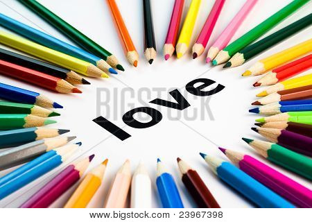 Many Colored Pencils Arranged In Circle On The Word Love