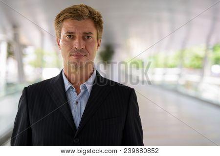 Portrait Of Businessman Relaxing At The Footbridge In Bangkok, Thailand