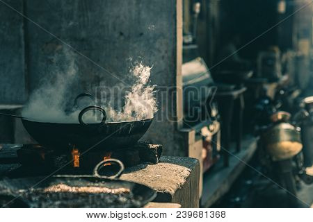 Street Food In India Cooking In Fatiscent Big Pan Or Wok In A Small Street Food Stall. White Smoke C