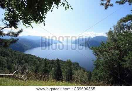 Kind On Lake Teletskoe, Siberia From Mountain Chichilgan.endless Taiga, Mountains And Water