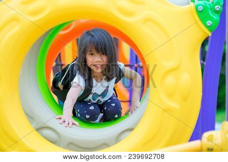 Asia Kid Girl Having Fun To Play On Children's Climbing Toy At School Playground,back To School Outd