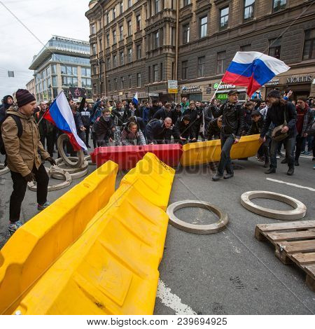 ST. PETERSBURG, RUSSIA - MAY 5, 2018: Opposition supporters on the Nevsky prospect during an opposition protest rally ahead of President Vladimir Putin's inauguration ceremony.