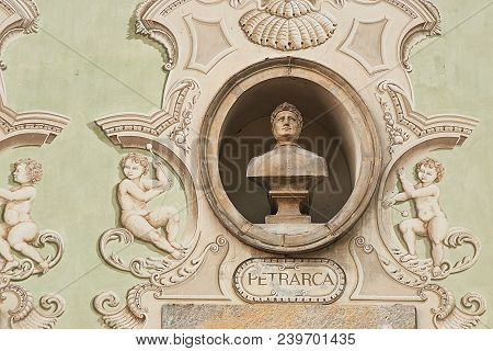 Vintage Sculpture Portrait Of Francesco Petrarca, A Scholar And Poet Of Renaissance Italy On A Facad