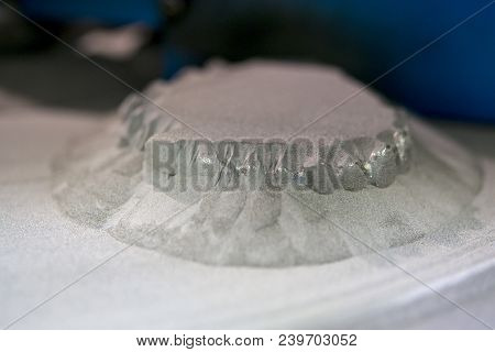 Object Printed On Metal 3d Printer, Laser Sintering Machine For Metal Close-up. A Metal Object Sprin