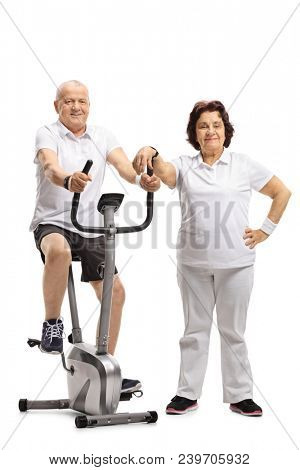 Mature man exercising on a stationary bike with a mature woman leaning on it isolated on white background poster