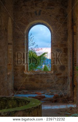 The Inner Room With Gap In The Wall Of The Abandoned Old Mansion Called Dacha Kvitko, Sochi, Russia