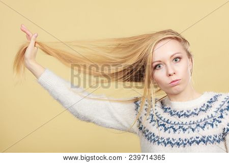 Haircare, Choosing Best Conditioner For Tangled Hairstyle Concept. Teenage Blonde Girl Brushing Her