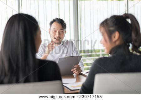 Smiling Businessman During Job Interview.job Interview Concept. Businessman Explaining And Listen To