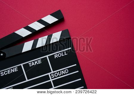 Movie Clapper On Red Background ; Film, Cinema And Video Photography Concept