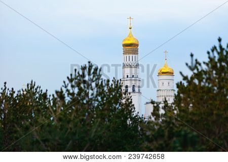 Golden Domes Of Ivan The Great Bell Tower. Gleaming Onion Domes, Whitewashed Octagonal Bell Tower, T