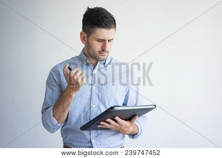 Portrait Of Serious Young Businessman With Folder And Pen. Caucasian Manager Wearing Blue Shirt Read