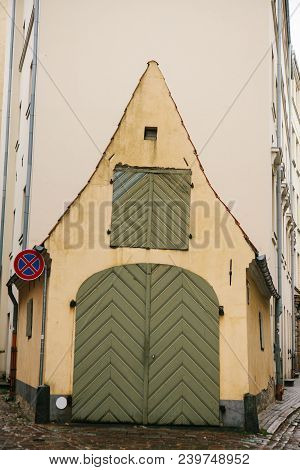 Design Of A Garage For A Car. Historical Building Or Architecture Monument Or Old Stable In Riga, La