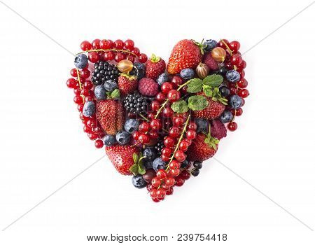 Heart Shape Assorted Berry Fruits On White Background. Berries In Heart Shape Isolated On A White. R