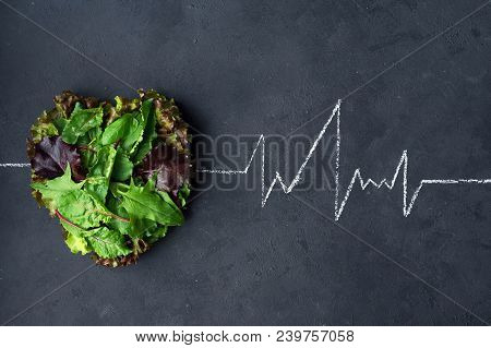 Healthy Eating Healthy Heart Cardiogram. Medical Background . Lettuce Laid Out In The Shape Of A Hea