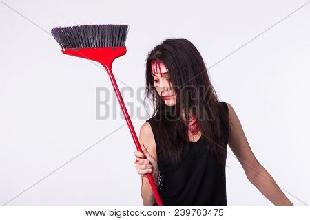 Beaten Sad Housewife Holding A Mop. She Is Victim Of Domestic Violence And Abuse Stands With Bruises