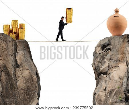 Businessman Moves A Pile Of Golden Coins To A Moneybox. Concept Of Difficulty To Saving Money
