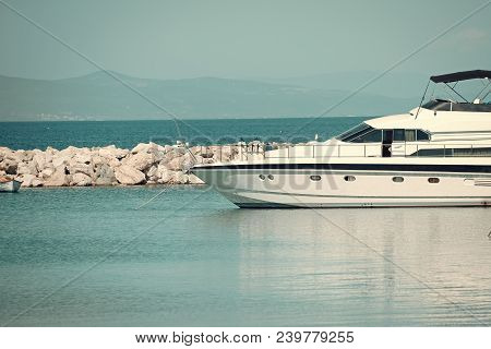 High Speed Boat, Luxury Yacht In Dock In Sea, Blue Sky On Background. White Luxury Yacht, Marine Gli