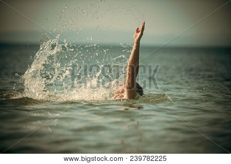 Male Hand Out Of Sea With Splashes Of Water. Swimming Concept. Guy Swimming Under Sea Water, Skyline