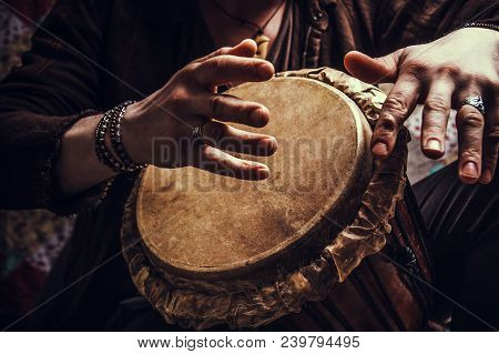 A Man Playing On Ethnic Percussion Musical Instrument Jembe