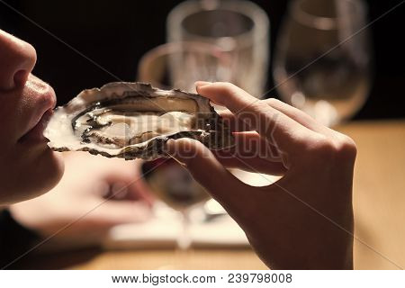 Woman Eating Shellfish. Seafood And Mediterranean Cuisine With Mussels In Shell. Young Woman Eating