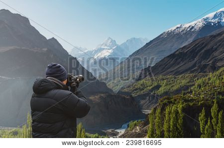 Photographer Taking Photograph Of Hunza Valley Landscape In Pakistan By Dslr Camera