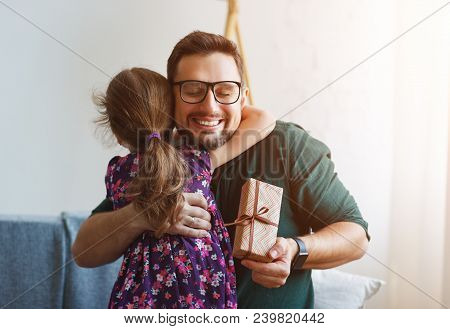 Father's Day. Happy Family Daughter Giving Dad Gift