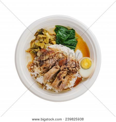 Stewed Pork Leg On Rice And Half Of Boiled Egg On Natural Bagasse Plate Isolated White Background In